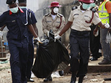 A body of a crash victim being carried away by the Nigerian police. File photo. Agencies.