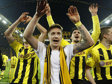 Borussia Dortmund's Marco Reus (C) and team mates celebrate after defeating Malaga to win the Champions League quarter-final. Reuters