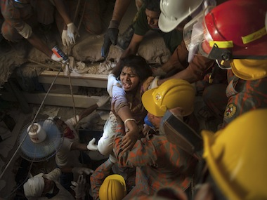 Rescue workers rescue a garment worker from the rubble of the collapsed Rana Plaza building, in Savar, 30 km (19 miles) outside Dhaka in 2013. File photo Reuters