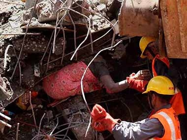 A rescue worker during the Thane building collapse. PTI.