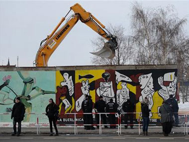 Demolition work on at the Berlin Wall.