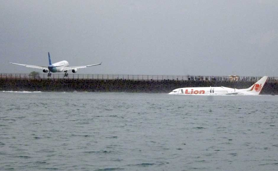 The wreckage a crashed Lion Air plane sits on the water near the airport in Bali, Indonesia on 13 April 2013. AP