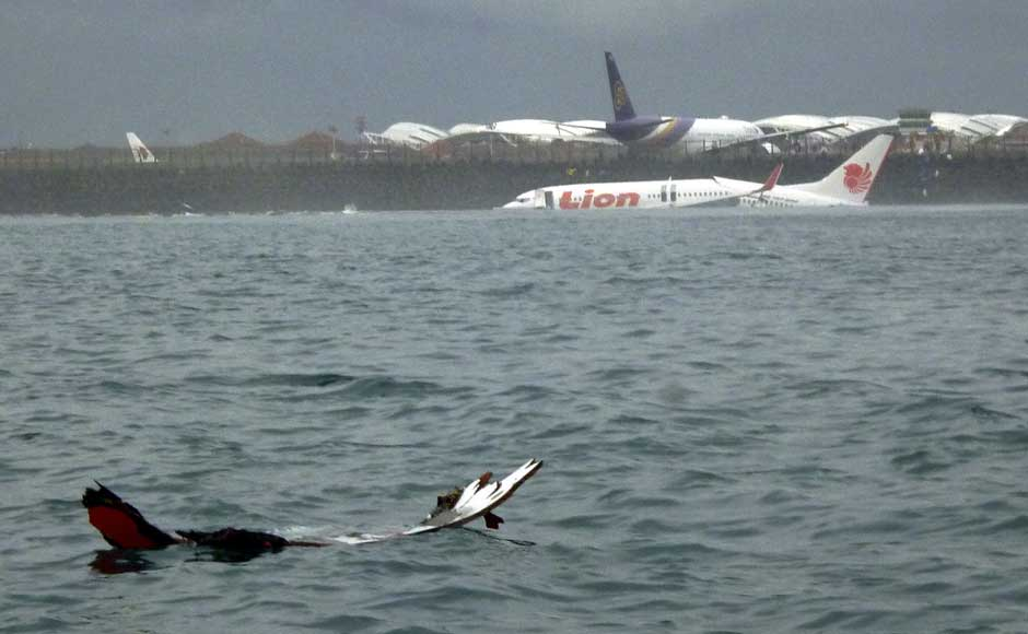 The wreckage a crashed Lion Air plane sits on the water near the airport in Bali, Indonesia on 13 April 2013.