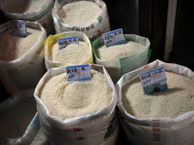 Rice is displayed on sale at a market in Shanghai. AFP