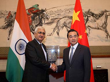 External Affairs Minister Salman Khurshid shakes hands with his Chinese counterpart Wang Yi in Beijing. PTI