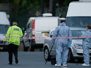 Police and forensic officers near the scene of the attack. AP