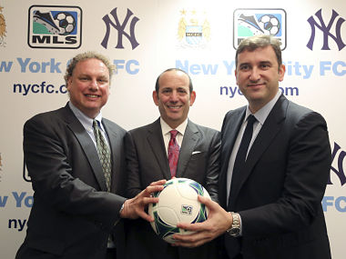 New York Yankees president Randy Levine, left, Major League Soccer Commissioner Don Garber, center, and Manchester City CEO Ferran Soriano at the MLS headquarter in New York on Tuesday. AP