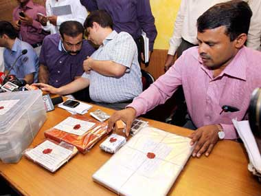 The Mumbai police with the evidence seized from Sreesanth's room. PTI