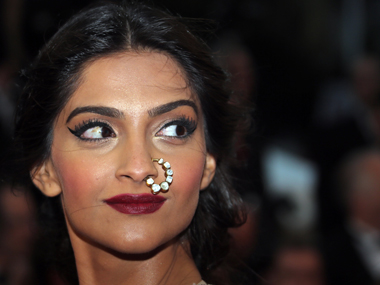 Sonam Kapoor poses on the red carpet as she arrives for the screening of the film 'The Great Gatsby' and for the opening ceremony of the 66th Cannes Film Festival in Cannes May 15, 2013. Reuters