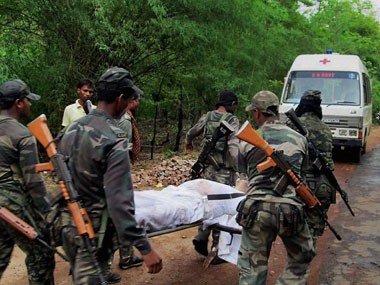 CRPF jawans carry of the body of a victim. PTI