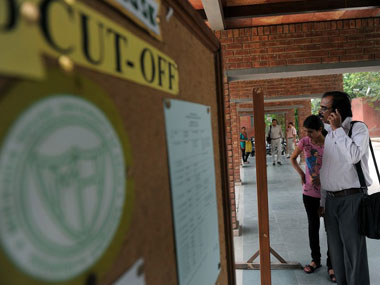 Not only students, even parents feel harangued by soaring cut-offs. AFP.