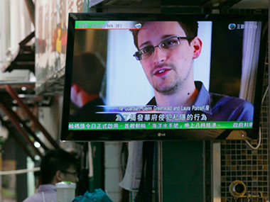 Edward Snowden claims he is not hiding in Hong Kong. AP