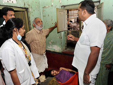 Karnataka health Minister U T Khader having a word with the parents of the 35-year-old Hemavathi, who was allegedly locked up in her house by them for last 4 years. PTI