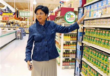PepsiCo CEO Indra Nooyi poses for a portrait by products at the Tops SuperMarket in Batavia, New York. Reuters