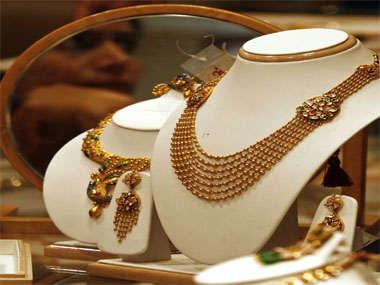 Under pressure to curb demand RBI further tightens gold import norms