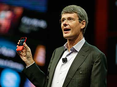 BlackBerry CEO Thorsten Heins with Q5 in this file photo. AP