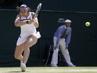 Marion Bartoli of France plays a return to Sabine Lisicki of Germany during their Women's singles final match in Wimbledon. AP