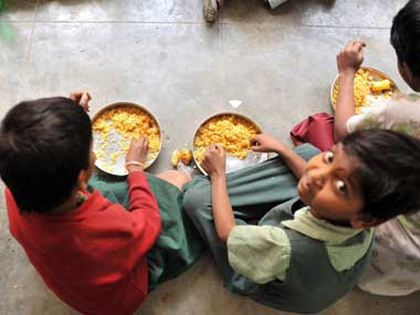 The midday meal scheme draws students to government schools. AFP