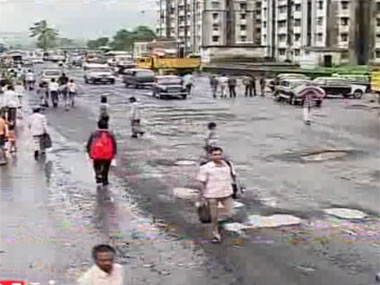 Image of a Mumbai road filled wih potholes. Screengrab from IBN-Live video