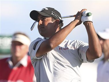 Shiv Kapur of India plays a shot off the 13th tee during the first round of the British Open Golf Championship. AP