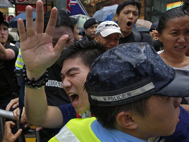 Protesters scuffle with police officers during an annual pro-democracy protest in Hong Kong. AP image