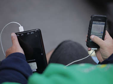 A file photo of a smartphone being charged. Reuters
