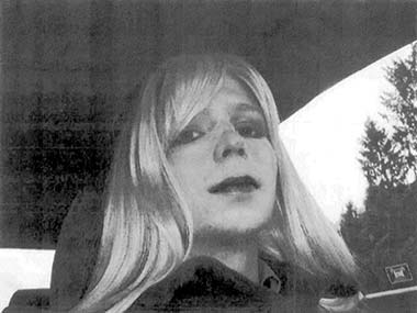 In this undated file photo provided by the U.S. Army, Pfc. Bradley Manning poses for a photo wearing a wig and lipstick. Manning plans to live as a woman named Chelsea and wants to begin hormone therapy as soon as possible, the soldier said.
