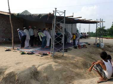 People in the village offering prayers at the mosque which is still to be completed. Naresh Sharma/ Firstpost