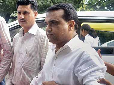 Co-owner of Micromax, Rajesh Agrawal (R), arrested by CBI in a bribery case, is produced in court in New Delhi. PTI