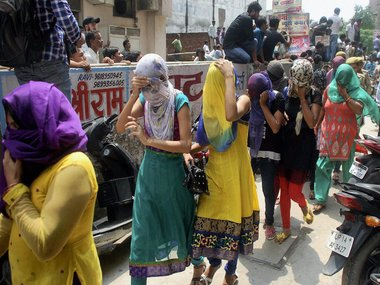 olice take away girls who were arrested for their alleged involvement in a sex racket in Ghaziabad on Saturday. PTI