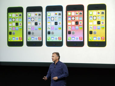 Phil Schiller, Apple's senior vice president of worldwide product marketing, speaks on stage during the introduction of the new iPhone 5c in Cupertino. AP