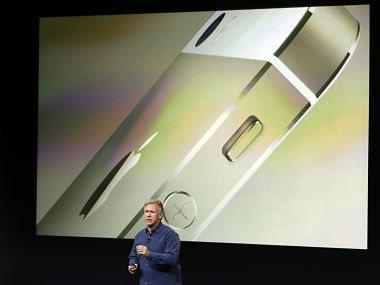 Phil Schiller, Apple's senior vice president of worldwide product marketing, speaks on stage during the introduction of the new iPhone 5s in Cupertino, Calif., Tuesday, Sept. 10, 2013. (AP Photo/Marcio Jose Sanchez)