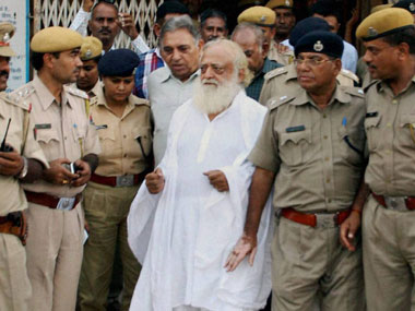 Controversial self-styled godman Asaram Bapu comes out of the District sessions court where he was produced after his arrest, in Jodhpur. PTI