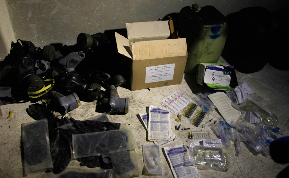 Chemical-materials-and-gas-masks-are-pictured-in-a-warehouse