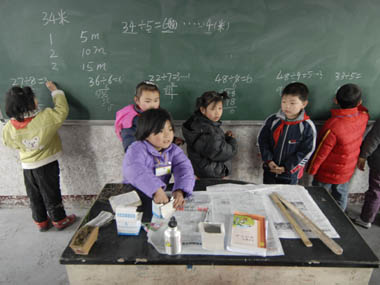 Pupils solve math problems at a primary school for the children of migrant labourers in Nanjing. Reuters