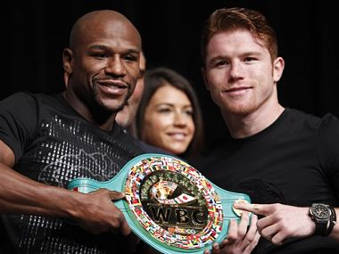 Boxers Floyd Mayweather, left, and Canelo Alvarez pose during a press conference in Las Vegas, Wednesday. AP