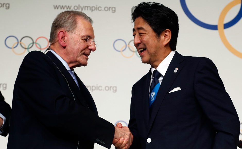 Prime-Minister-Shinzo-Abe-(R)-of-Japan-shakes-hands-with-Jacques-Rogge,-president-(IOC)