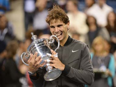 Nothing tastes sweeter than a Grand Slam trophy. AFP