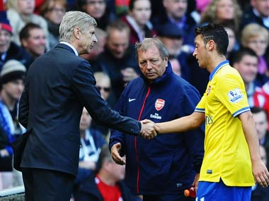 File photo of Arsene Wenger and Mesut Ozil. Getty Images
