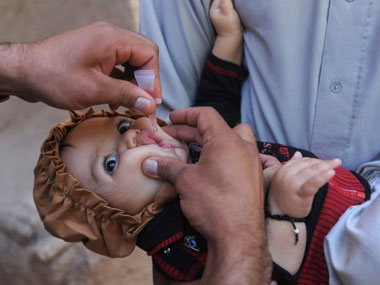 A baby being administered the polio vaccine. Agencies.