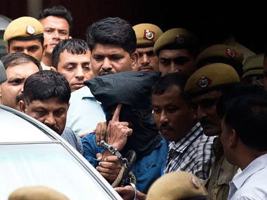 NIA taking Yasin Bhatkal (in the black hood) from the court premises. AFP.