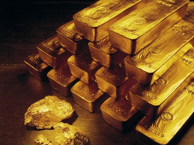 Gold prices near fourmonth low as Fed Reserve stance boosts dollar yellow metal on course for a weekly drop