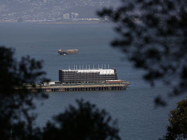 A barge built with four levels of shipping containers is seen at Pier 1 at Treasure Island in San Francisco. Reuters