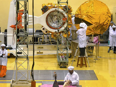Scientists working on a Mars Orbiter Vehicle in ISRO. AFP.