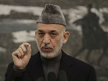 Afghan President Hamid Karzai gestures during a press conference at the presidential palace in Kabul, Saturday, Nov. 16, 2013. Karzai announced that the final draft of a contentious Bilateral Security Agreement with the United States has been completed ahead of a traditional loya Jirga, or grand council, convened to discuss the critical pact. Both countries have signed off on the draft. AP