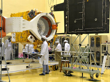 Scientists work on the Mars Orbiter vehicle at Isro's Bangalore centre. AFP