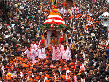 Devotees climbing Rath Its all about the money stupid