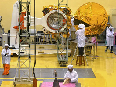 Scientists and engineers work on a Mars Orbiter vehicle at the Indian Space Research Organisation's satellite centre in Bangalore. AFP