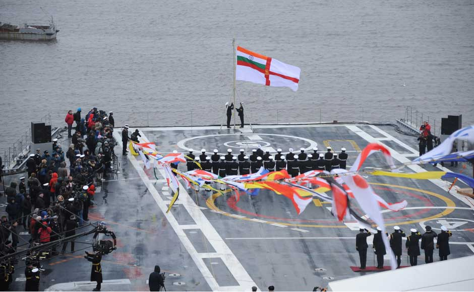 The Indian Navy flag is hoisted on INS Vikramaditya as it is commissioned into Indian Navy, at Sevmash Shipyard in Russia on 16 November 2013. Image courtesy PIB