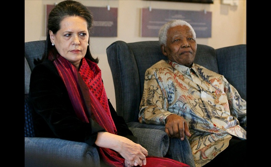Former South African president and Nobel peace prize laureate Nelson Mandela (R) receives, 22 August 2007 Sonia Gandhi (L), the President of the Indian National Congress and the leader of the ruling Indian Congress Alliance at the Mandela Foundation in Johannesburg during her four day working visit to South Africa. Gandhi presented a smiling Mandela with a book entitled 'Gandhi's Way' which celebrated a centenary of Mahatma Gandhi's philosophy of peace and humanity. AFP